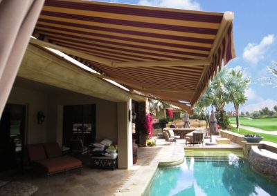 Retractable Awning Over Swimming Pool at Golf Course House