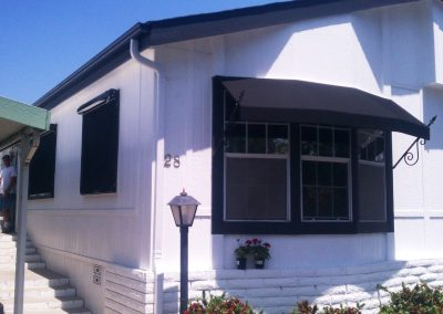 Black Awning on Manufactured Home