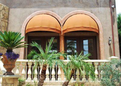 Double Orange Window Awnings