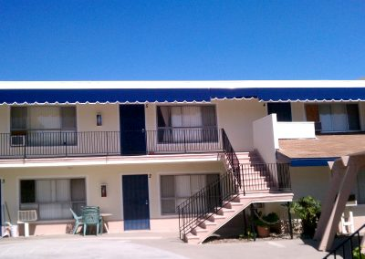 Blue Awning on Motel Balcony