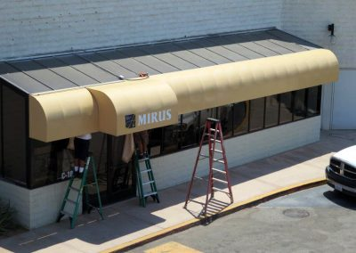 Tan Commercial Awning Over Storefront