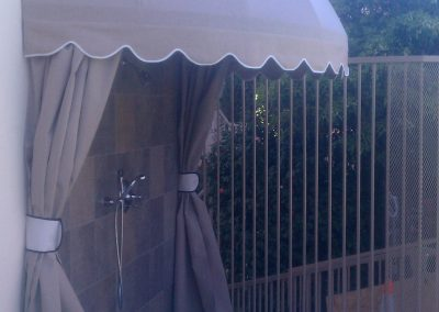 Tan Awning Over Shower with Drapes